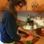 Carly cutting scallions for potato salad